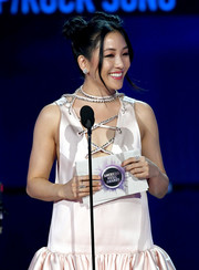 Constance Wu flashed some dainty diamond rings while speaking onstage at the 2019 American Music Awards.