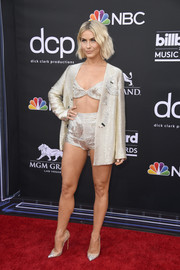 Julianne Hough flashed plenty of skin in a gold jacket, bra, and hot pants combo by Genny at the 2019 Billboard Music Awards.