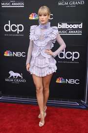 Taylor Swift showed off her fabulous legs in a heavily ruffled lilac mini dress by Raisa & Vanessa at the 2019 Billboard Music Awards.