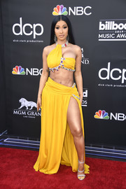 Cardi B channeled her inner belly dancer in a bejeweled yellow bra top by Moschino at the 2019 Billboard Music Awards.