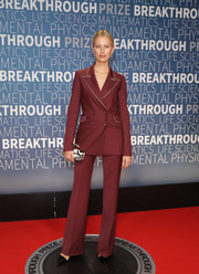 Karolina Kurkova opted for a double-breasted maroon pantsuit when she attended the 2019 Breakthrough Prize.