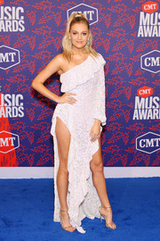 Kelsea Ballerini teamed her dress with silver ankle-strap sandals by Jimmy Choo.