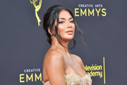 Nicole Scherzinger wore her hair in a romantic chignon at the 2019 Creative Arts Emmy Awards.