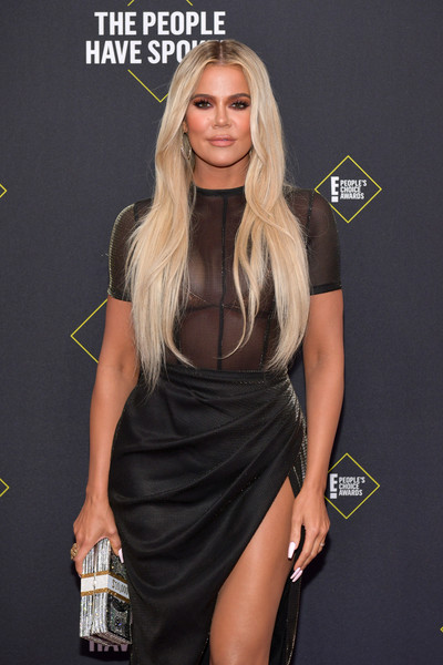 Khloe Kardashian arrived for the 2019 E! People's Choice Awards carrying the Judith Leiber Stack of Cash Rich clutch.