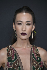 Maggie Q wore her hair in a center-parted ponytail at the 2019 E! People's Choice Awards.