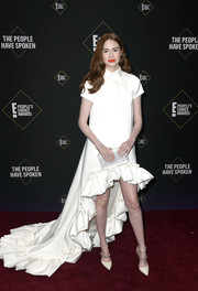 Karen Gillan looked playfully glam in a white high-low dress with a ruffled hem at the 2019 E! People's Choice Awards.