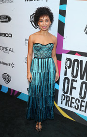 Logan Browning looked party-ready in a strapless turquoise gown with a fringed skirt at the 2019 Essence Black Women in Hollywood Awards.