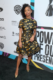 Marsai Martin complemented her dress with a pair of gold pumps.