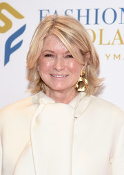 Martha Stewart accessorized with a pair of oversized gold hoops.