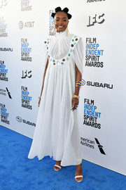 Kiki Layne went boho in a loose, stone-embellished white dress by Chloe at the 2019 Film Independent Spirit Awards.