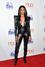Ciara kept the edgy vibe going with a pair of black lace-up boots.
