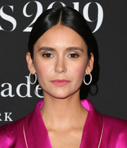 Nina Dobrev went old school with this center-parted bun at the 2019 InStyle Awards.