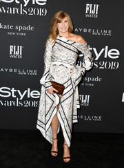 Connie Britton looked cool and chic in an off-the-shoulder, handkerchief-hem print dress by Jonathan Simkhai at the 2019 InStyle Awards.