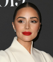 Olivia Culpo highlighted her full lips with a bold red hue.