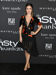 Rachel Bilson chose a black and orange floral dress with a plunging neckline and a sheer, asymmetrical skirt for the 2019 InStyle Awards.