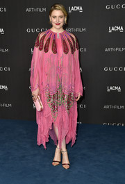 Greta Gerwig chose a caped pink dress with red and green sequin detailing for the 2019 LACMA Art + Film Gala.
