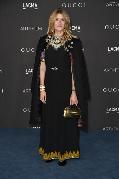 Laura Dern topped off her dress with an embellished black coat, also by Gucci.