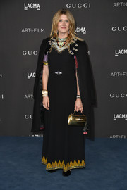 Laura Dern added a bright spot with a metallic gold purse.