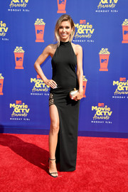 Audrina Patridge punctuated her black look with a gold Alexander McQueen clutch.