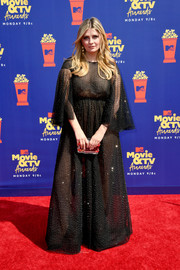 Mischa Barton paired her dress with an acrylic clutch.