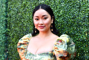 Lana Condor complemented her colorful outfit with a pair of dangling gemstone earrings by Swarovski.
