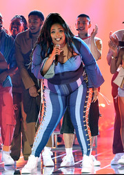 Lizzo performed at the 2019 MTV Movie & TV Awards wearing a denim top in various shades of blue.