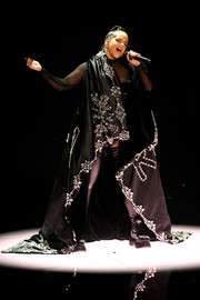 Rosalia was all about goth glamour in a bejeweled black cape while performing at the 2019 MTV VMAs.