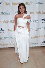 Gina Rodriguez showed off her tan in a white one-shoulder crop-top at the 2019 Maui Film Festival.