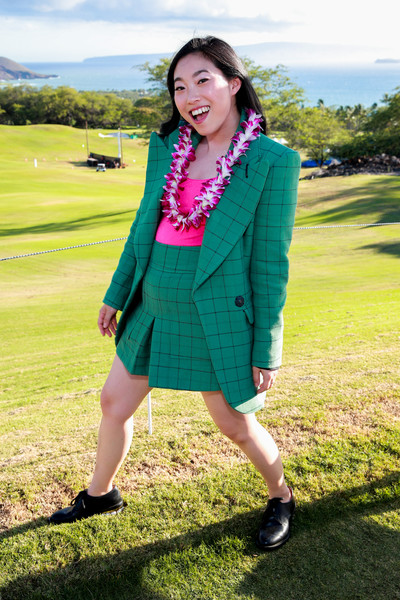 Awkwafina teamed black leather lace-ups with a green short suit for the 2019 Maui Film Festival.