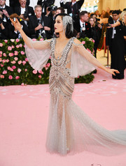 Constance Wu gave us sexy Cleopatra vibes with this sheer, beaded gown by Marchesa at the 2019 Met Gala.