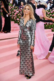 Sienna Miller shimmered in a scallop-patterned silver gown by Paco Rabanne at the 2019 Met Gala.