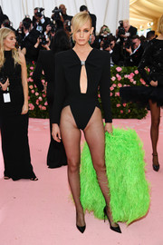 Amber Valletta smoldered in a high-cut black bodysuit by Saint Laurent at the 2019 Met Gala.
