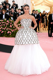 Sara Sampaio channeled her inner princess in a strapless August Getty Atelier ballgown with a lattice top and a voluminous tulle skirt at the 2019 Met Gala.