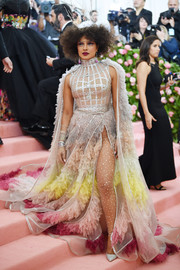 Priyanka Chopra looked theatrical in a Dior Couture gown with a lattice bodice and an ombre ruffled cape and skirt at the 2019 Met Gala.