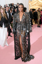 Gabrielle Union looked fierce in a sheer, plunging gown by Dundas at the 2019 Met Gala.