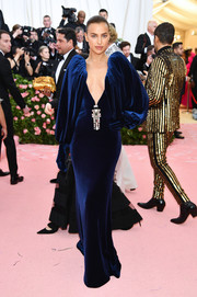 Irina Shayk chose a blue Burberry velvet dress with a plunging neckline and statement sleeves for the 2019 Met Gala.