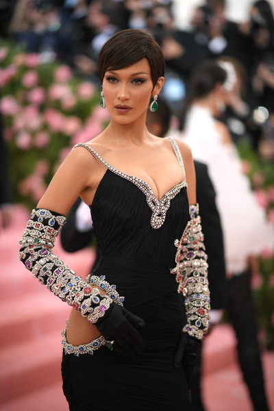 Bella Hadid rocked a pair of heavily jeweled gloves at the 2019 Met Gala.