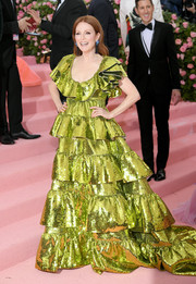 Julianne Moore radiated in a tiered chartreuse sequined gown by Valentino Couture at the 2019 Met Gala.