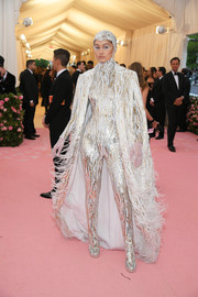 Gigi Hadid looked like she just stepped out of a sci-fi movie in this silver and gold catsuit by Michael Kors at the 2019 Met Gala.