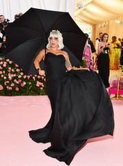 For one of her four Brandon Maxwell looks during the 2019 Met Gala, Lady Gaga went goth-glam in a strapless black gown with a voluminous side bustle.