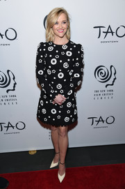 A pair of white Saint Laurent pumps with black ankle straps completed Reese Witherspoon's well-coordinated look.