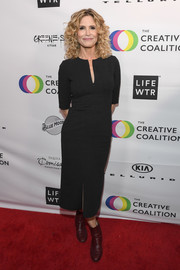 Kyra Sedgwick styled her dress with burgundy ankle boots.