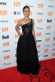 Natalie Portman was all about edgy elegance in a black one-shoulder gown by  Christian Dior Couture at the TIFF premiere of 'Lucy in the Sky.'