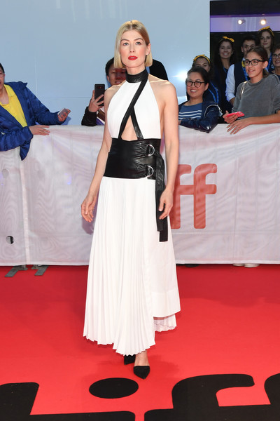 Rosamund Pike was edgy-glam in a white Proenza Schouler cutout gown with black leather detailing at the TIFF premiere of 'Radioactive.'