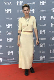 Kristen Stewart kept it relaxed in a yellow crop-top by Bec & Bridge at the TIFF press conference for 'Seberg.'