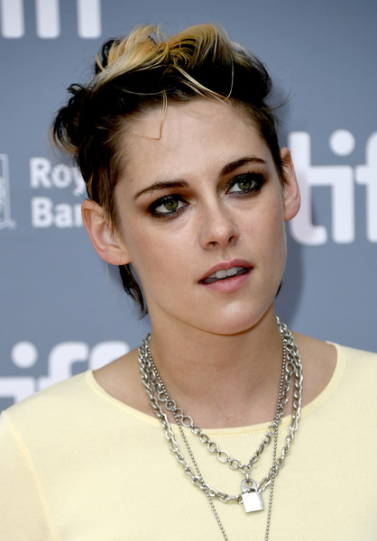 Kristen Stewart teamed her edgy 'do with a smoky eye.