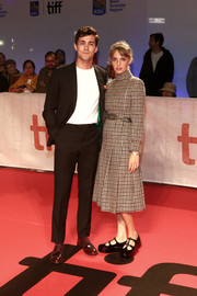 Maya Hawke chose a high-neck houndstooth dress by Celine for the TIFF premiere of 'The Song of Names.'