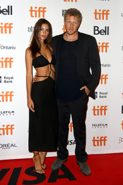 Emily Ratajkowski went majorly sexy in a black Christopher Esber cutout dress with a strappy midsection at the TIFF premiere of 'Uncut Gems.'
