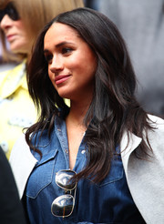 Meghan Markle wore her hair in a loose, center-parted style while enjoying a US Open match.