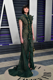 Rumer Willis attended the 2019 Vanity Fair Oscar party wearing a sexy green lace gown by Sebastian Gunawan.